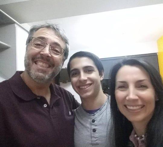Daniel Di Martino, center, with his parents in Caracas, Venezuela, in December 2016.