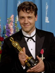 """Russell Crowe poses with his Oscar for best actor for his work in """"Gladiator"""" at the 73rd annual Academy Awards, in this Sunday, March 25, 2001."""