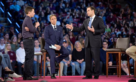 Marjory Stoneman Douglas High School student Cameron Kasky and Sen. Marco Rubio in Sunrise, Florida, on Feb. 21, 2018.