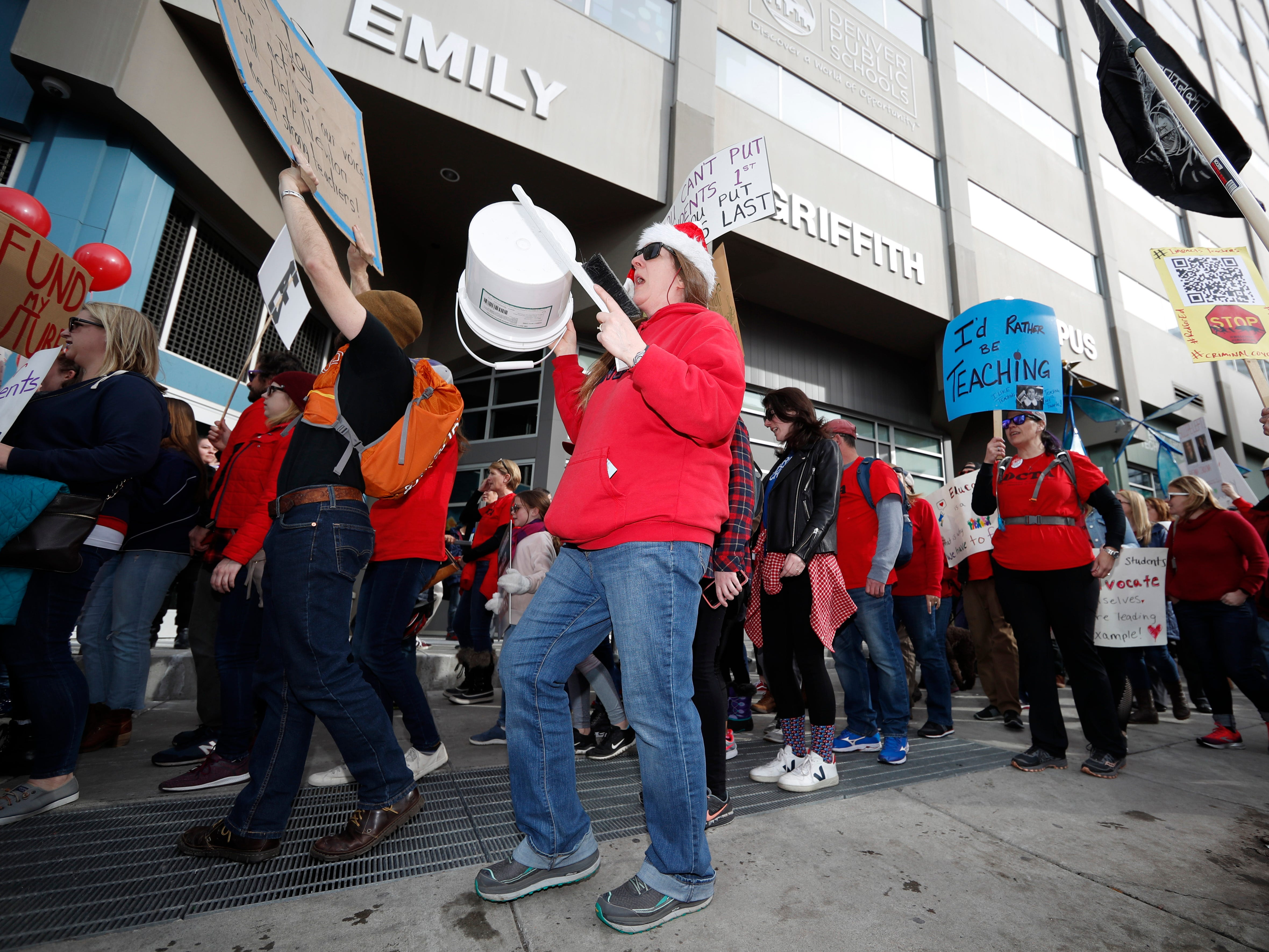 Instructors march to Denver Public Schools headquarters to deliver Valentine Day cards Feb. 13, 2019, in Denver.