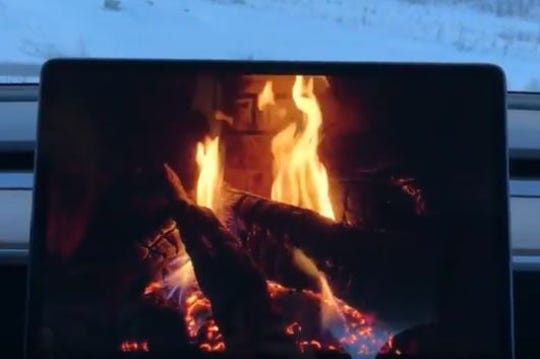 "Tesla's ""Romance Mode"" includes a roaring fire and sexy music"