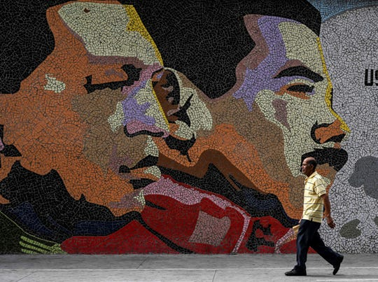 Mosaic depicts late Venezuelan President Hugo Chavez, left, and Venezuelan President Nicolas Maduro in Caracas on Jan. 30, 2019.