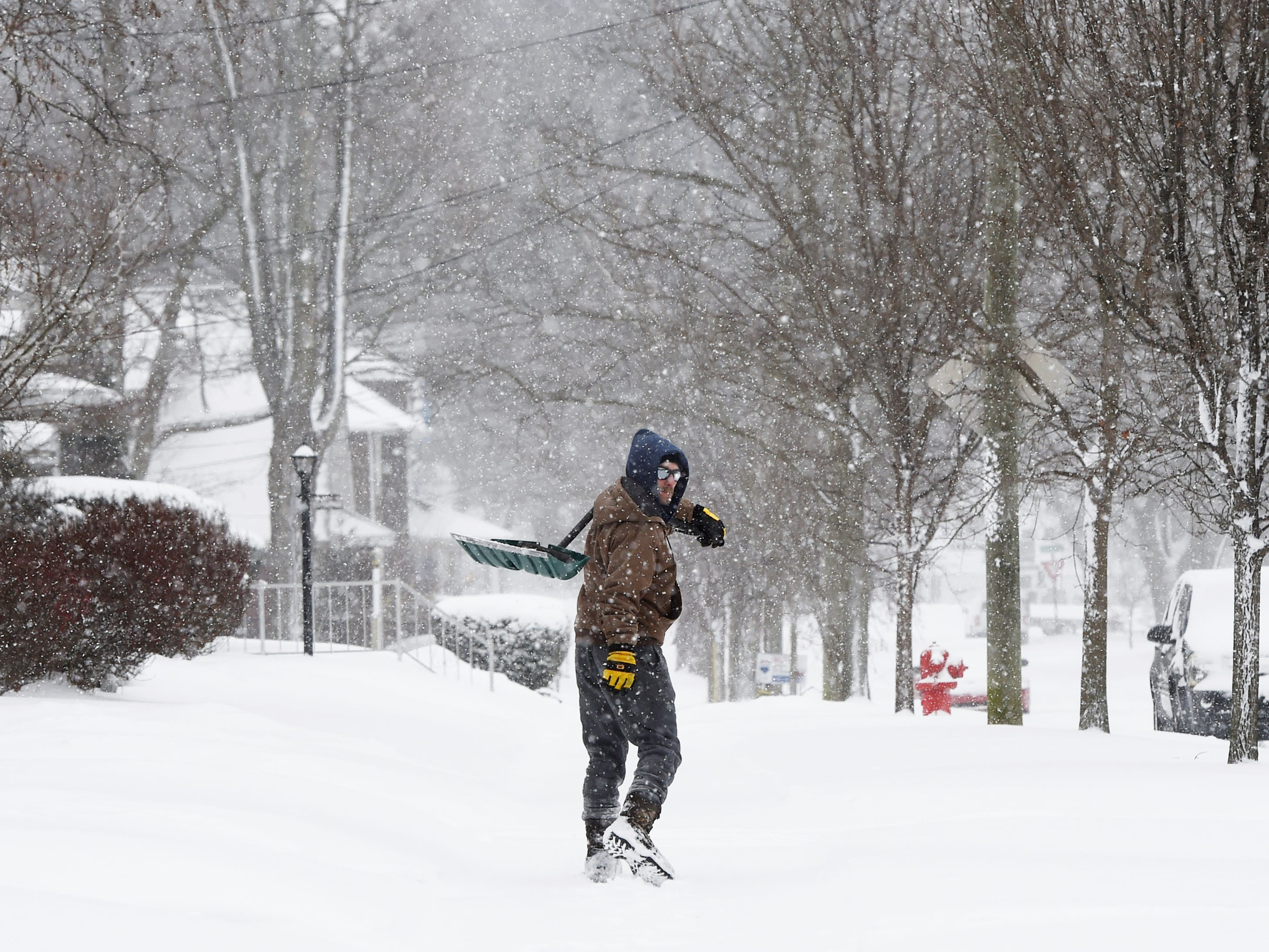 A man walks in Jackson, Mich. during a winter storm on Feb. 13, 2019.