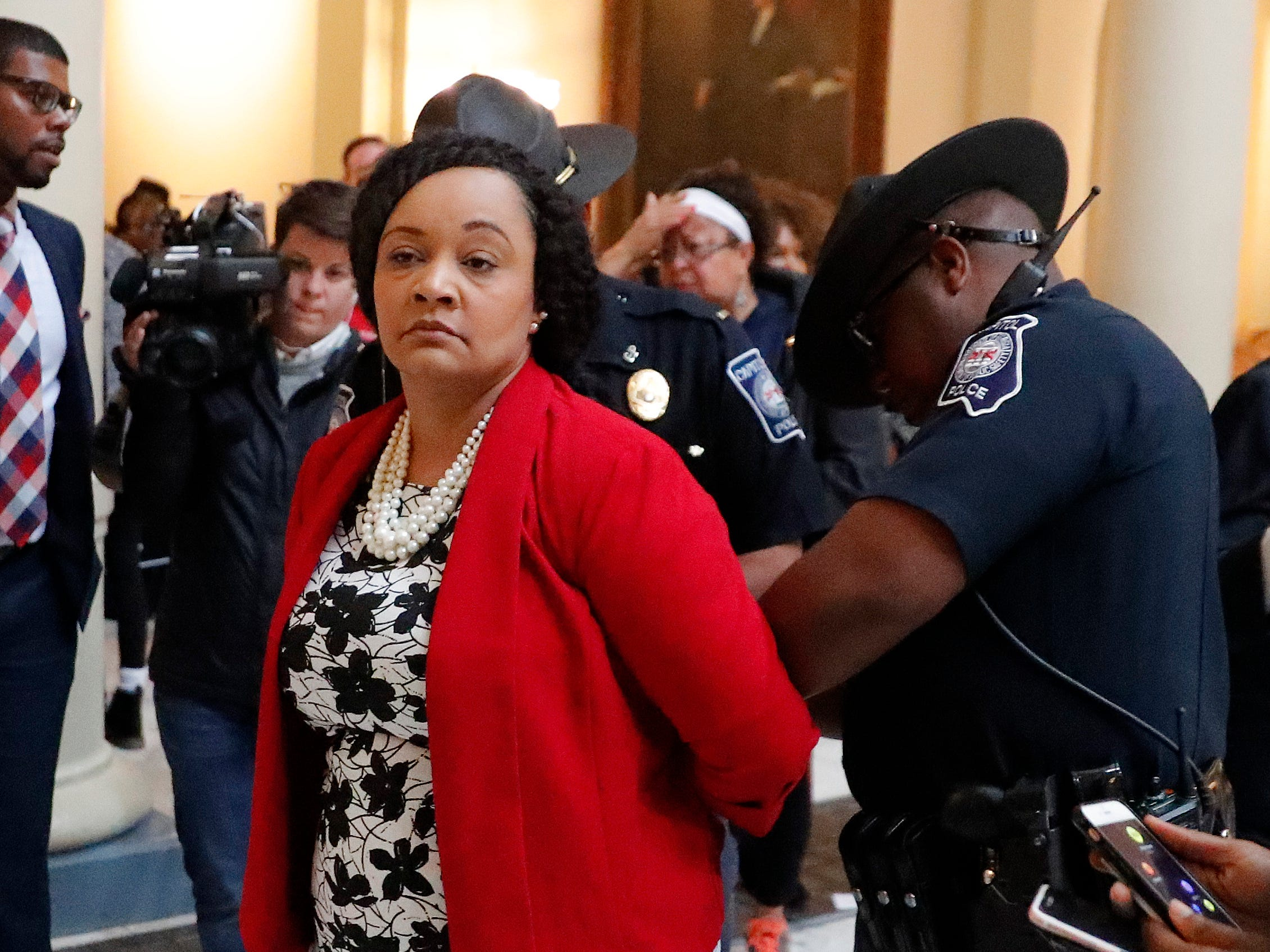 State Sen. Nikema Williams (D-Atlanta) is arrested by capitol police. Dozens of demonstrators had filled the rotunda of the Capitol building in Atlanta on Nov. 13, 2018, to protest election ballot counts.