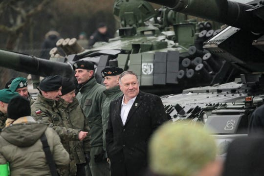 Secretary of State Mike Pompeo, center, visits NATO soldiers in Poland, on Feb. 13, 2019. Pompeo is in Poland for a summit on the Middle East.