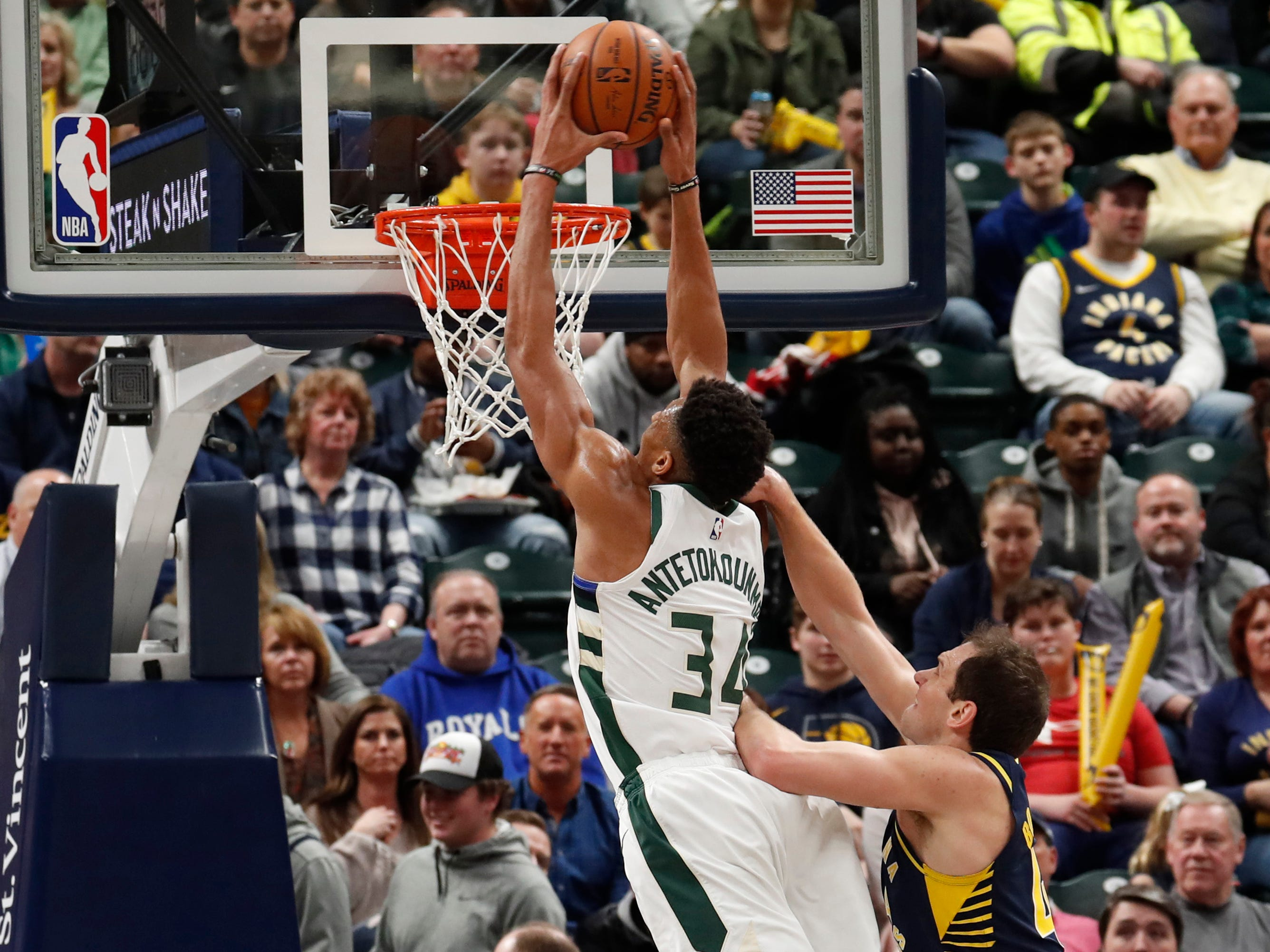 Feb. 13: Bucks forward Giannis Antetokounmpo (34) throws down the two-handed flush against Pacers defender Bojan Bogdanovic (44) in Indianapolis.