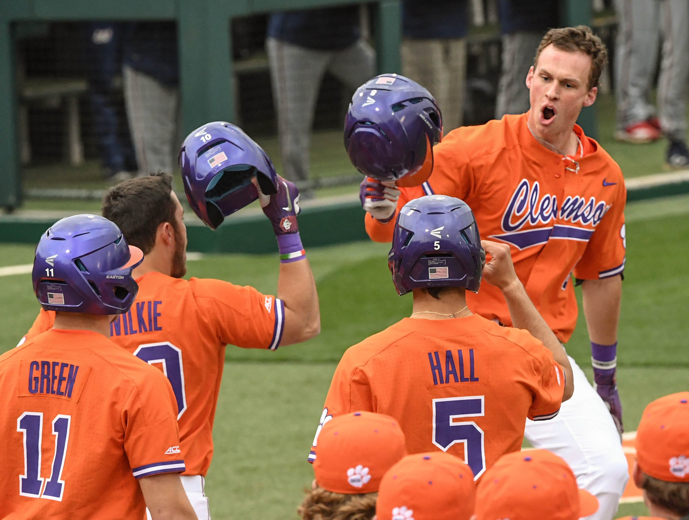 Clemson junior Logan Davidson(8) is congratulated by teammates after he hit a three-run home run against South Alabama during the bottom of the fifth inning at Doug Kingsmore Stadium in Clemson Friday, February 15, 2019.