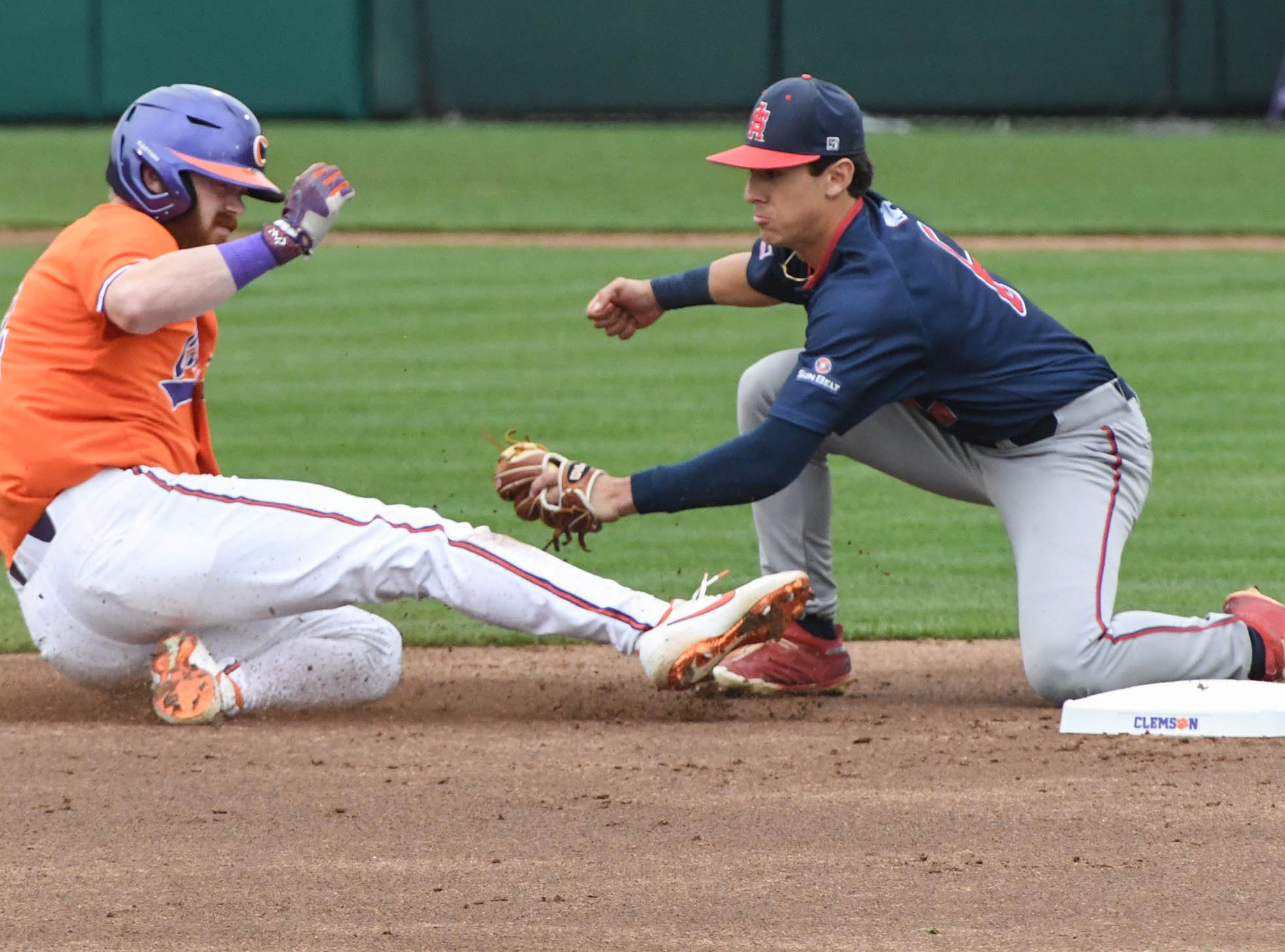 Clemson senior Grayson Byrd(4) is tagged out by South Alabama infielder Santi Montiel (6) during the top of the third inning at Doug Kingsmore Stadium in Clemson Friday, February 15, 2019.