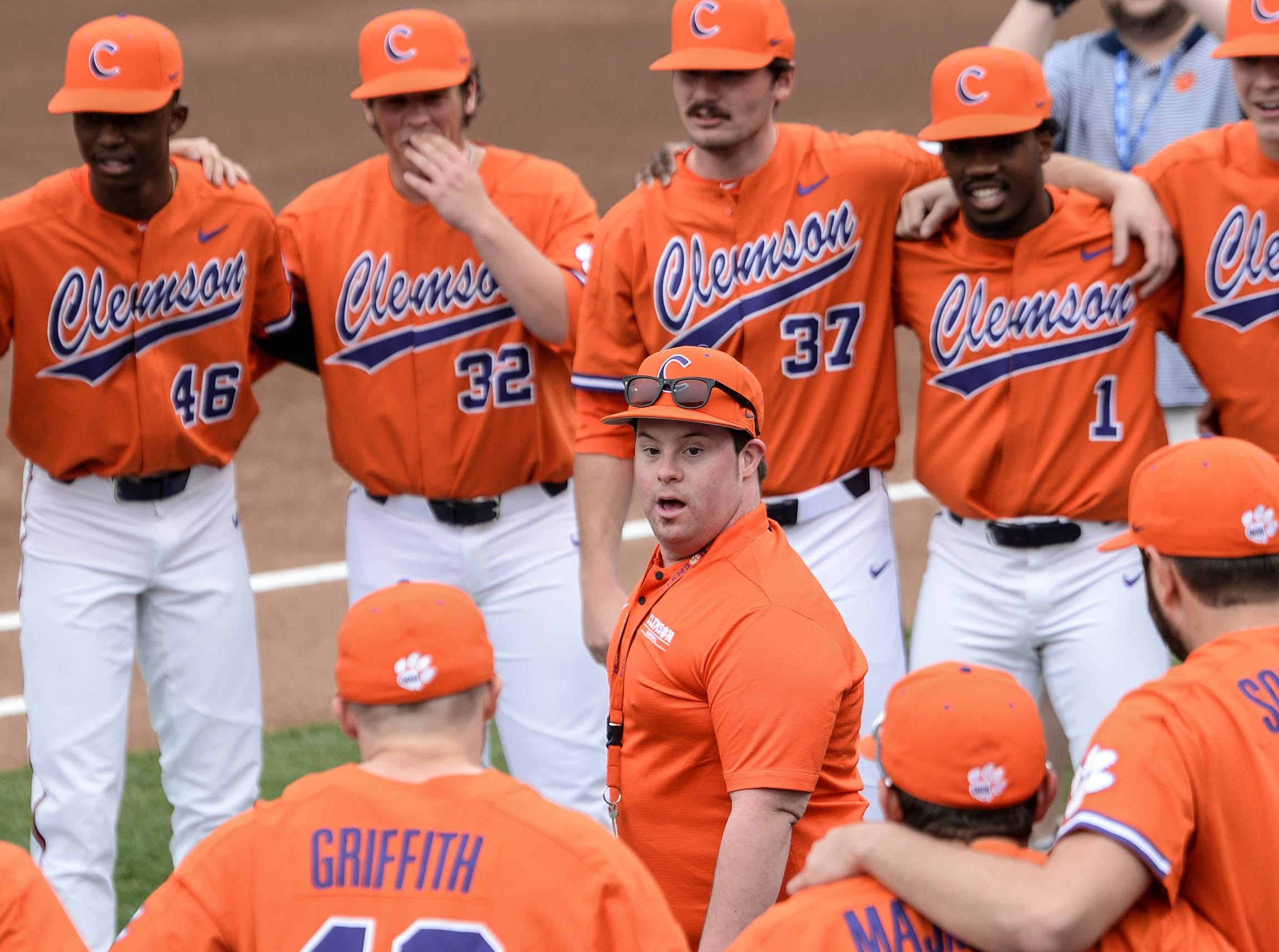 Clemson team manager Zach Buchanan leads a team cheer before the game with South Alabama at Doug Kingsmore Stadium in Clemson Friday, February 15, 2019.