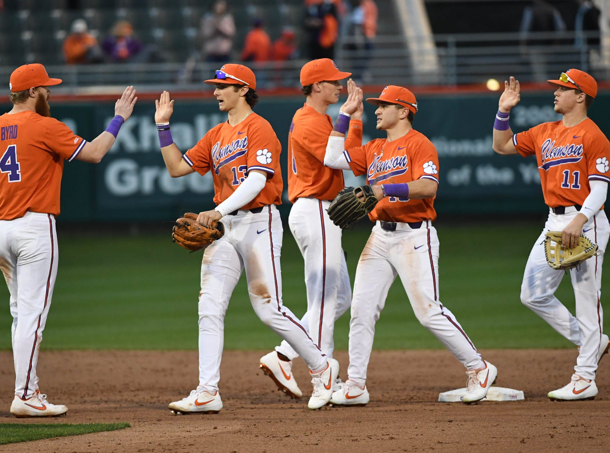 Clemson players celebrate a 6-2 win over South Alabama in the season opener at Doug Kingsmore Stadium in Clemson Friday, February 15, 2019.