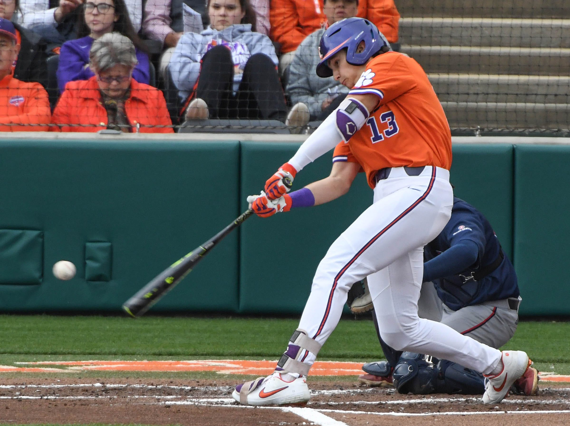 Clemson sophomore Bryce Teodosio(13) swings against South Alabama during the bottom of the third inning at Doug Kingsmore Stadium in Clemson Friday, February 15, 2019.