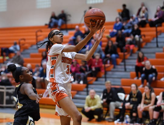 Eighth-grader Anaya Muhammad (3) scored 19 points Thursday as Southside edged Pendleton 48-47 in the second round of the Class AA state playoffs.