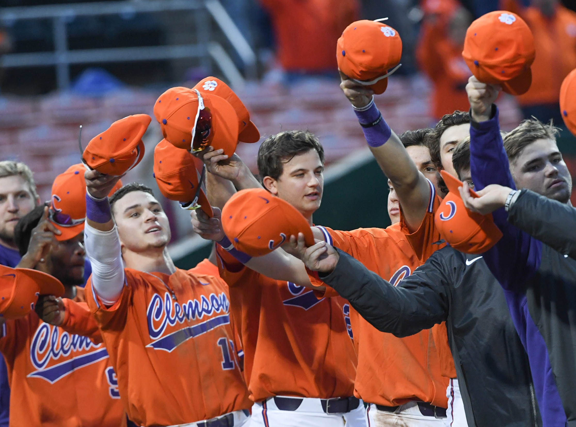 Clemson players point to the Cheap Seats fans in right field after joining in the alma mater.  The Tigers won 6-2 versus South Alabama in the season opener at Doug Kingsmore Stadium in Clemson Friday, February 15, 2019.