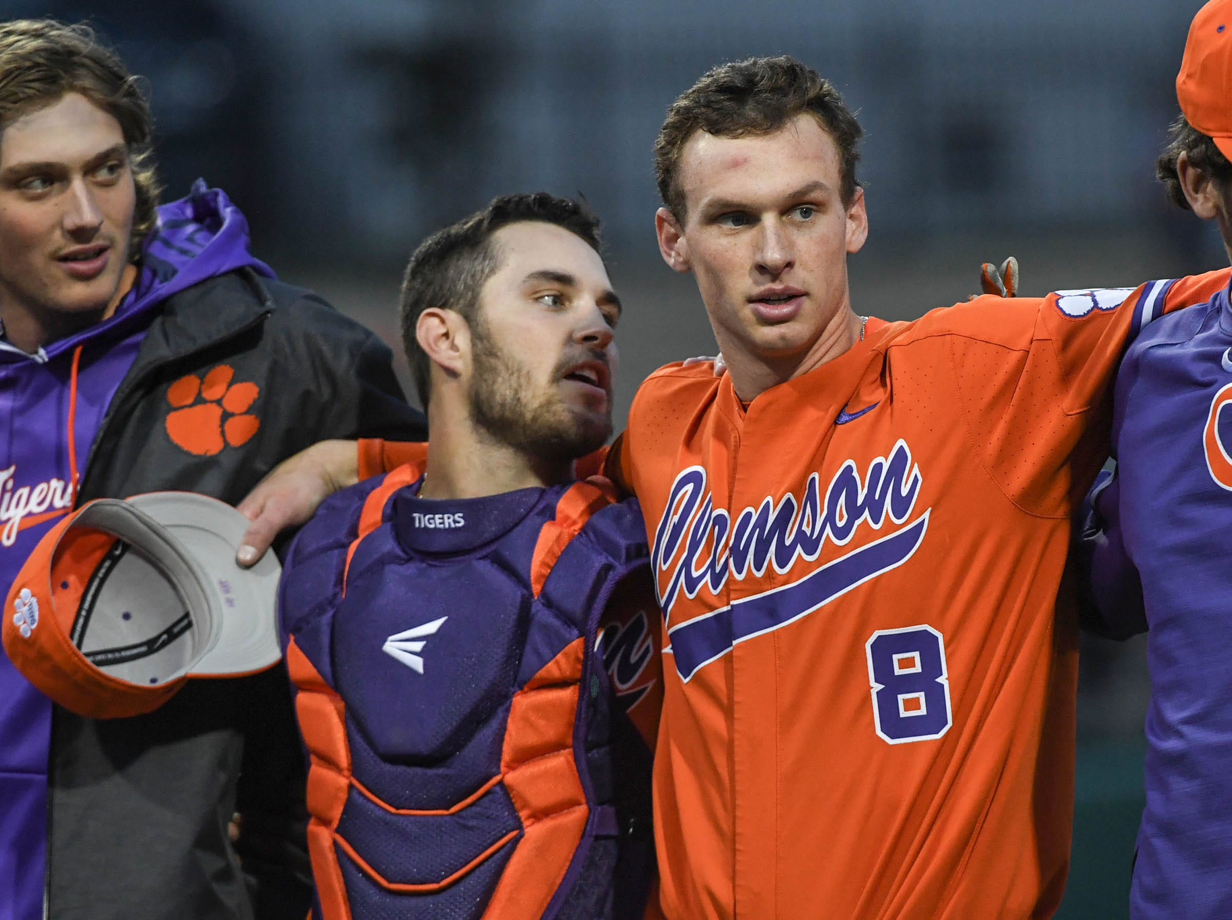 Clemson junior Kyle Wilkie(10), left, and junior Logan Davidson(8), right, senior Grayson Byrd(4), during the alma mater after a 6-2 win over South Alabama in the season opener at Doug Kingsmore Stadium in Clemson Friday, February 15, 2019.