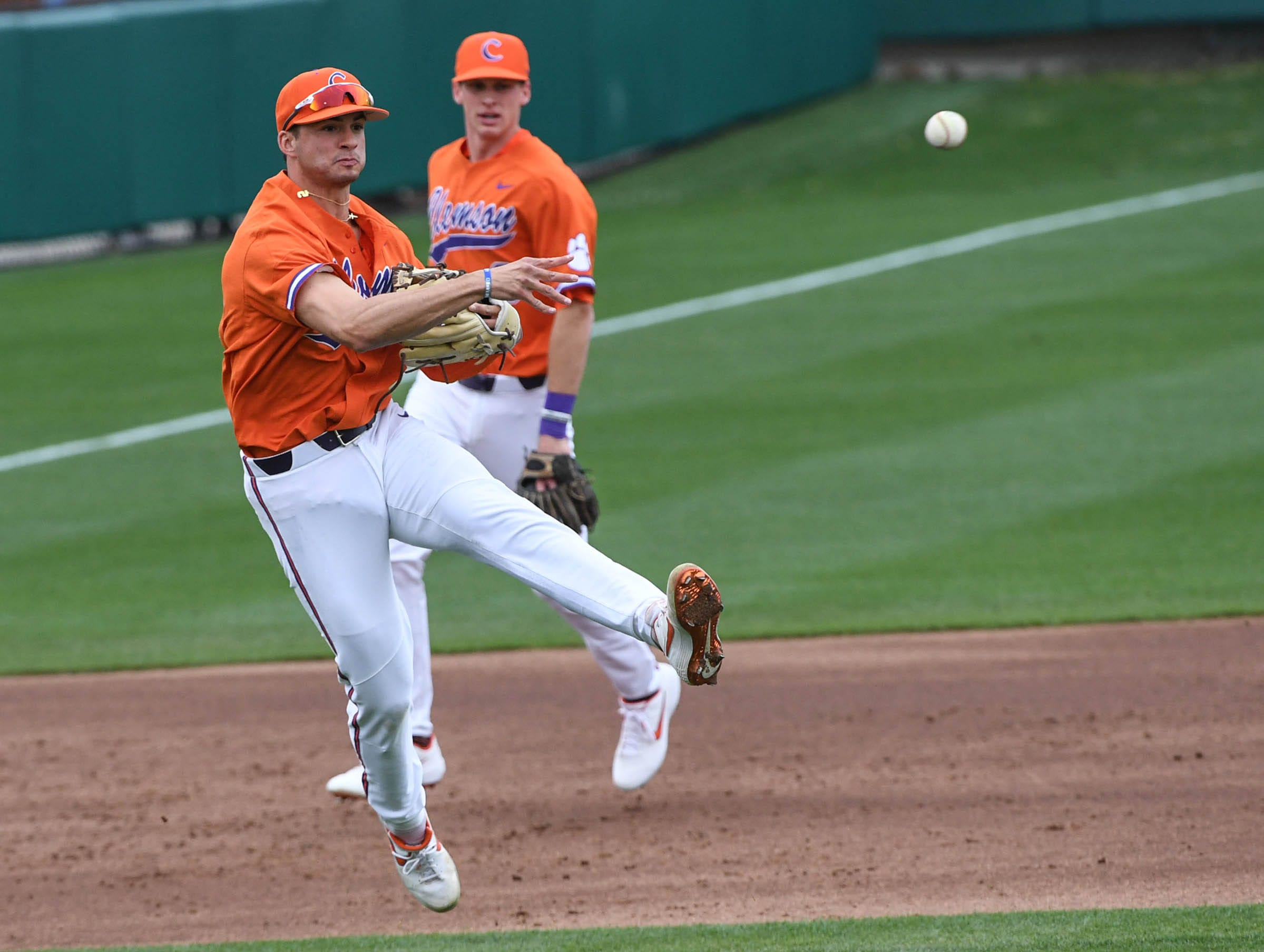 Clemson sophomore Sam Hall(5) throws to first base against South Alabama during the top of the fourth inning at Doug Kingsmore Stadium in Clemson Friday, February 15, 2019.