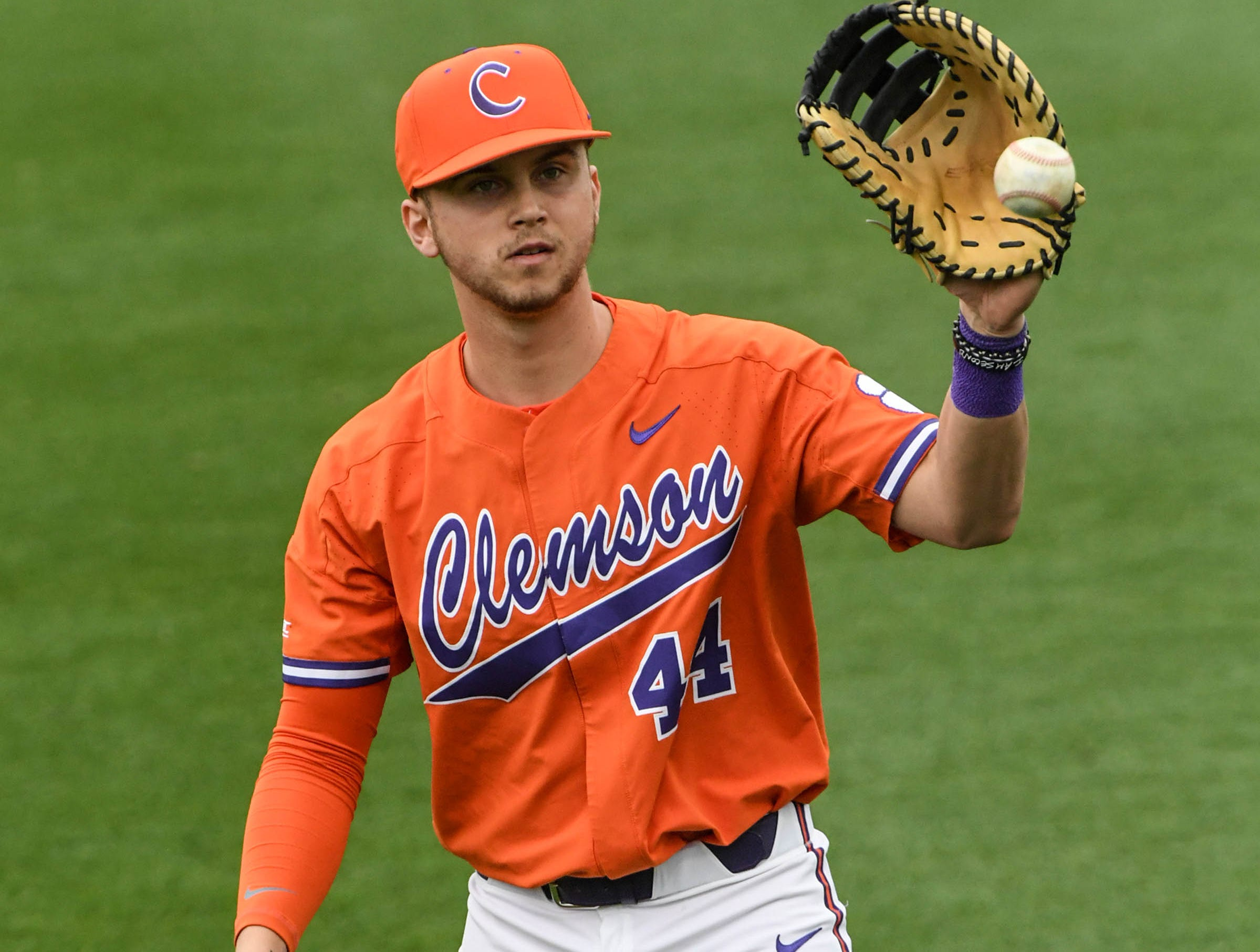 Clemson freshman Bryar Hawkins(44) warms up before the game with South Alabama at Doug Kingsmore Stadium in Clemson Friday, February 15, 2019.