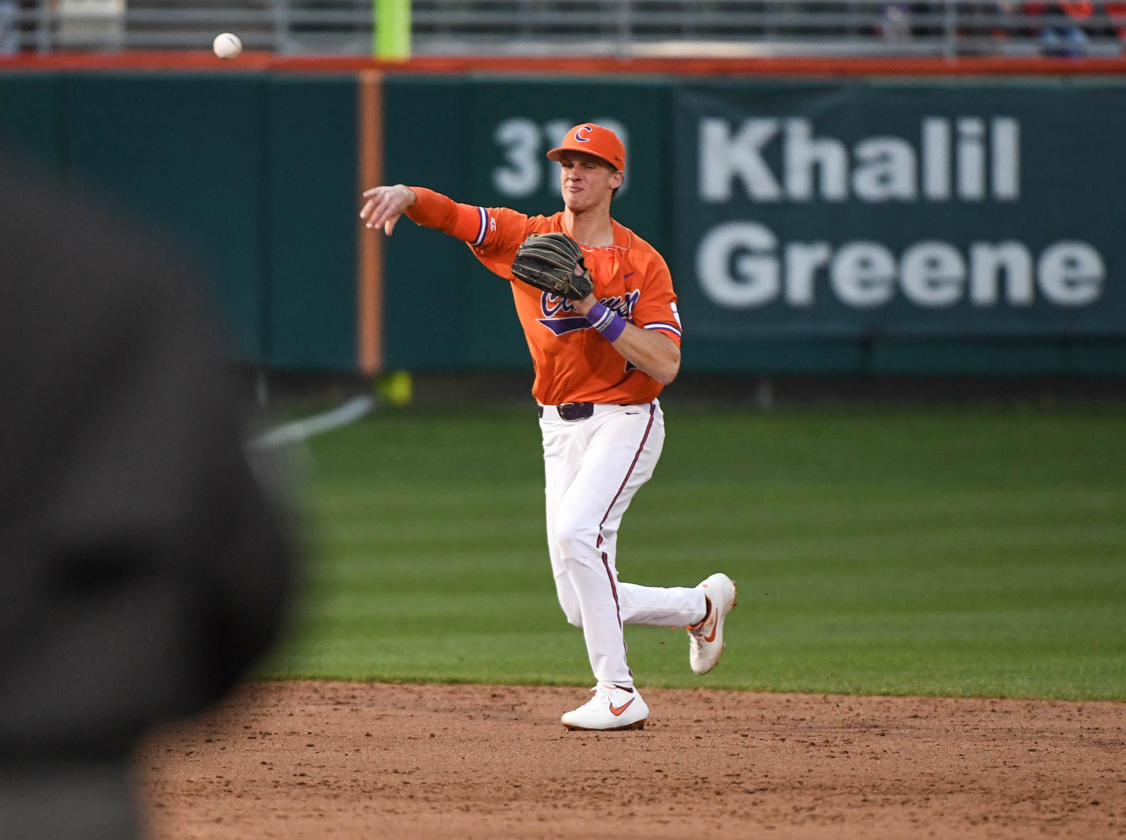 Clemson junior Logan Davidson(8) throws to first base playing South Alabama during the top of the ninth inning at Doug Kingsmore Stadium in Clemson Friday, February 15, 2019.