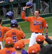 Clemson junior Logan Davidson(8) celebrates his three-run home run against South Alabama during the bottom of the fifth inning at Doug Kingsmore Stadium in Clemson Friday, February 15, 2019.
