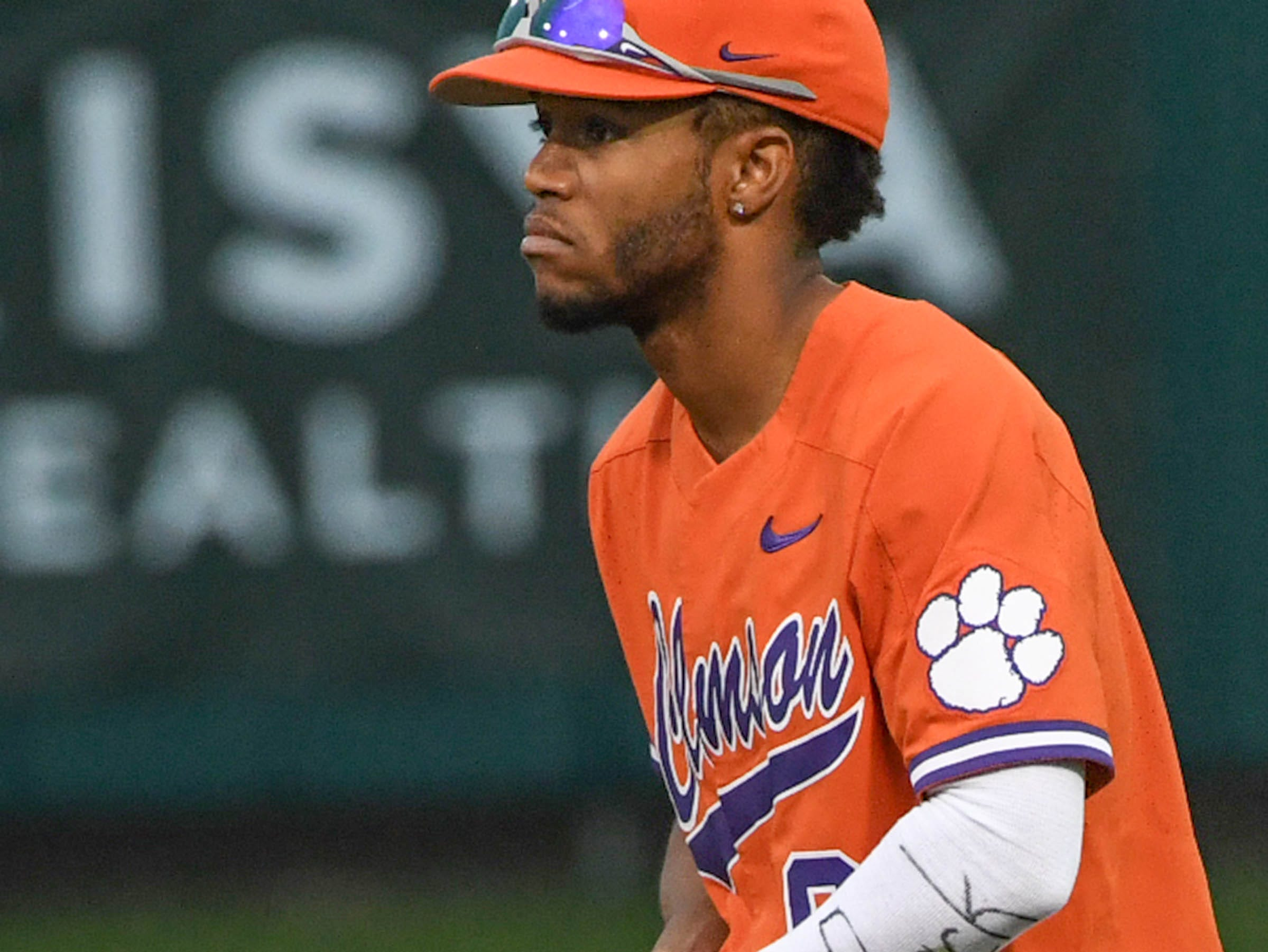 """Clemson infielder Jordan Greene(9) with """"We Back"""" written on his sleeve, for the season opener against South Alabama during the top of the ninth inning at Doug Kingsmore Stadium in Clemson Friday, February 15, 2019."""