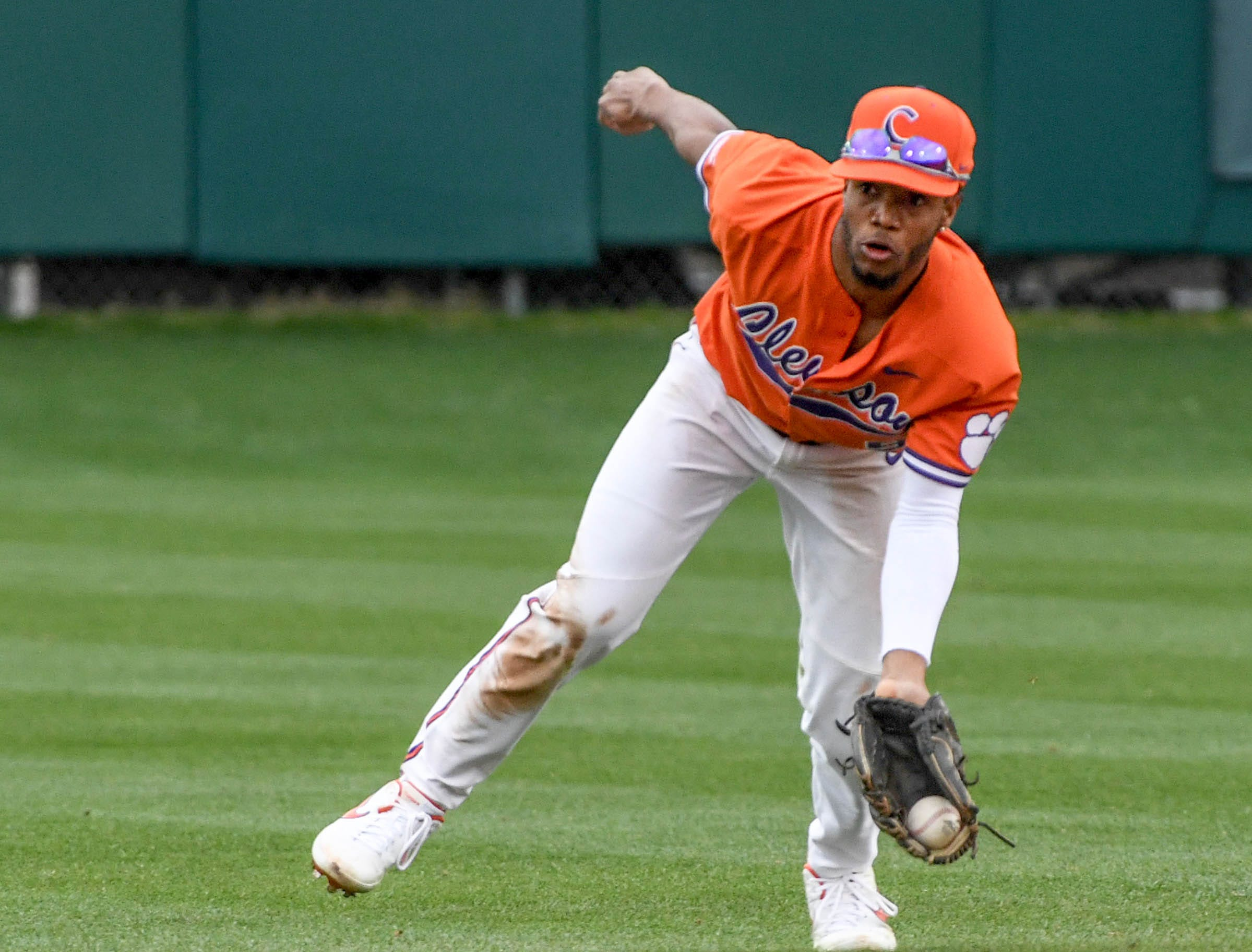 Clemson infielder Jordan Greene(9) scoops a ground ball against South Alabama during the top of the fifth inning at Doug Kingsmore Stadium in Clemson Friday, February 15, 2019.