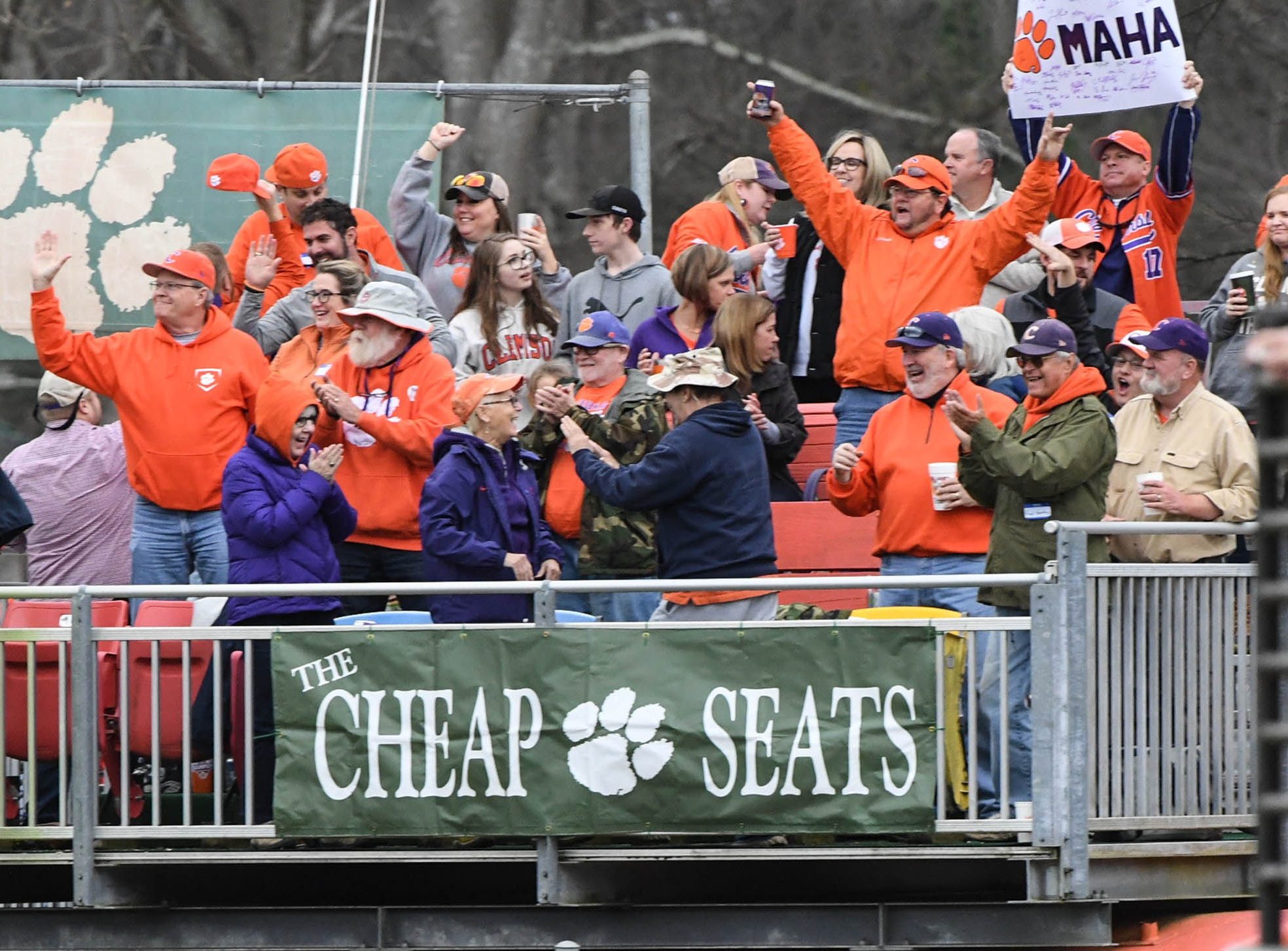 Cheap seats fans cheer after Clemson junior Logan Davidson(8) hit a three-run home run against South Alabama during the bottom of the fifth inning at Doug Kingsmore Stadium in Clemson Friday, February 15, 2019.
