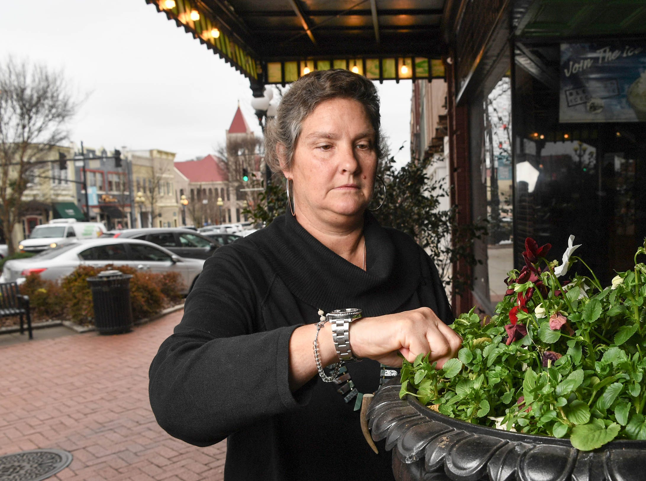 Sabra Nickas, co-owner of Sullivan's Metropolitan Grill, makes cheesecakes and cakes, also takes care of many other restaurant items including a display of flowers at the front door in downtown Anderson in February.  The restaurant reached its 20th anniversary.