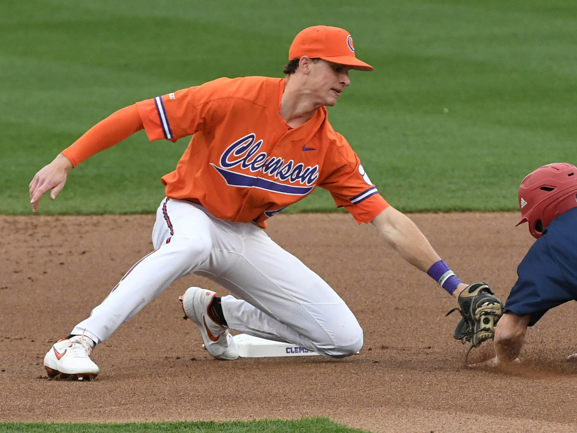 Clemson junior Logan Davidson(8) tags out South Alabama out fielder Ethan Wilson (34) at second base during the top of the sixth inning at Doug Kingsmore Stadium in Clemson Friday, February 15, 2019.