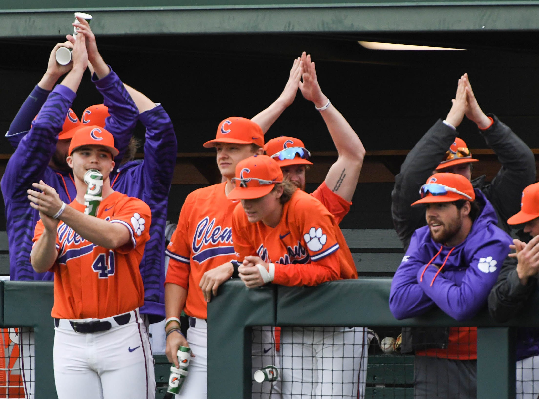 Clemson players clap to a song by Billy Squier playing over the stadium in the game with South Alabama during the bottom of the fourth inning at Doug Kingsmore Stadium in Clemson Friday, February 15, 2019.