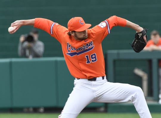 Clemson senior Brooks Crawford(19) pitches during the top of the fourth inning at Doug Kingsmore Stadium in Clemson Friday, February 15, 2019.