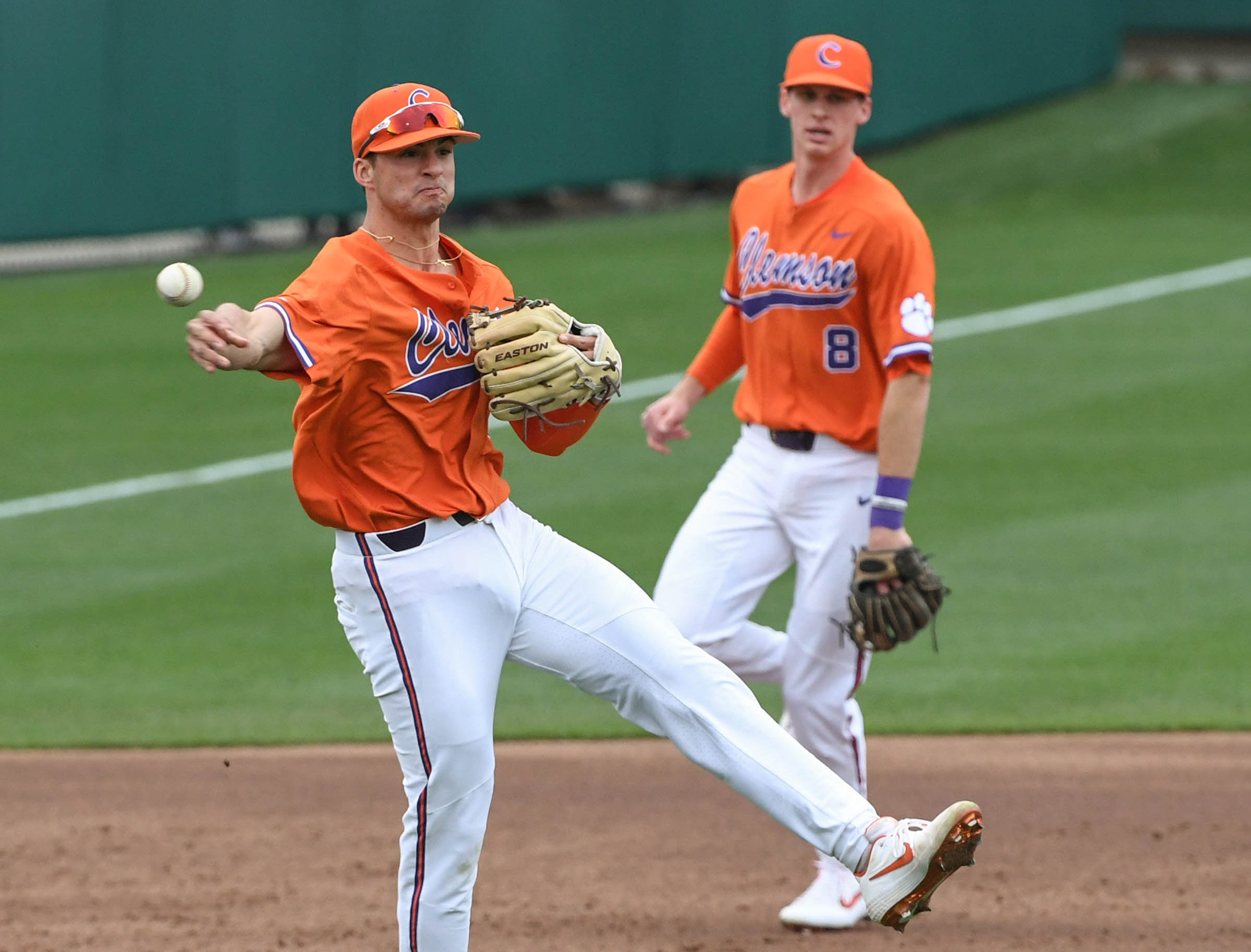 Clemson sophomore Sam Hall(5) throws out a South Alabama runner during the top  of the second inning at Doug Kingsmore Stadium in Clemson Friday, February 15, 2019.