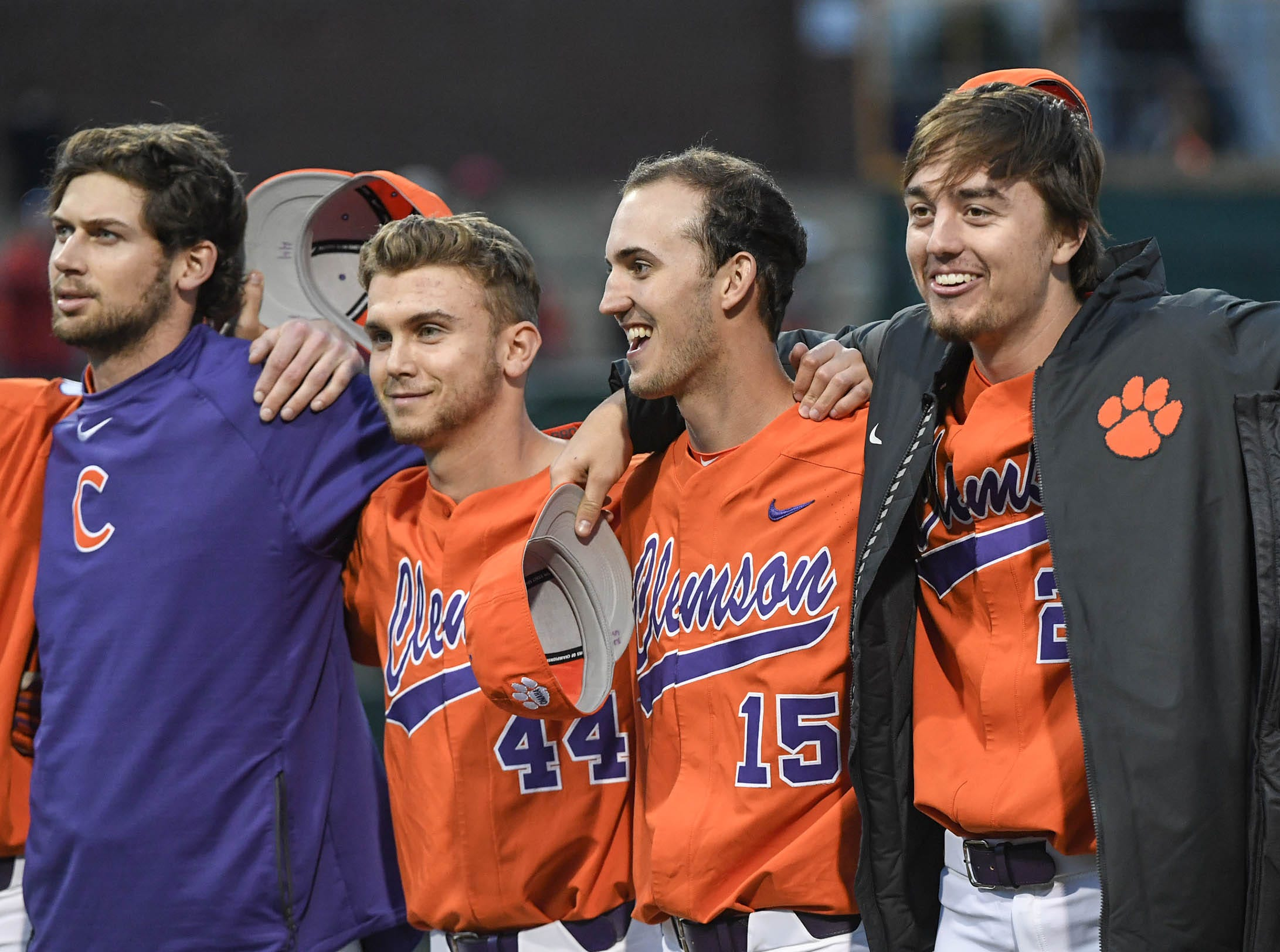 Clemson players freshman Bryar Hawkins(44), freshman James Parker(15), and freshman Jackson Lindley(25) during the alma mater after a 6-2 win over South Alabama in the season opener at Doug Kingsmore Stadium in Clemson Friday, February 15, 2019.