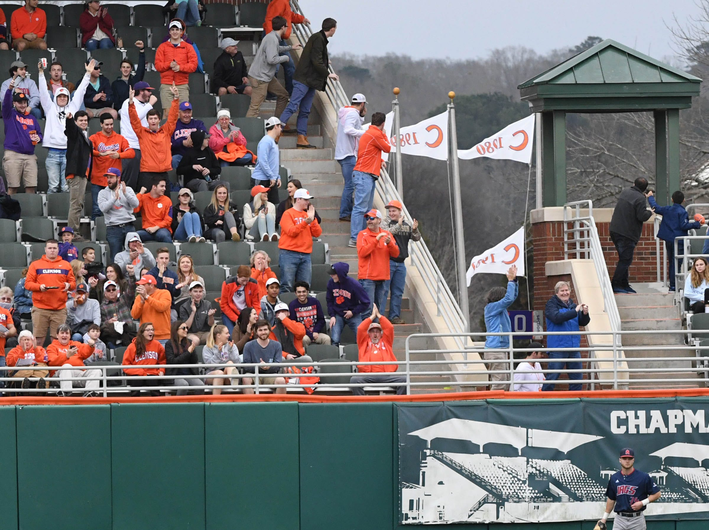 Fans cheer after Clemson junior Logan Davidson(8) hit a three-run home run against South Alabama during the bottom of the fifth inning at Doug Kingsmore Stadium in Clemson Friday, February 15, 2019.