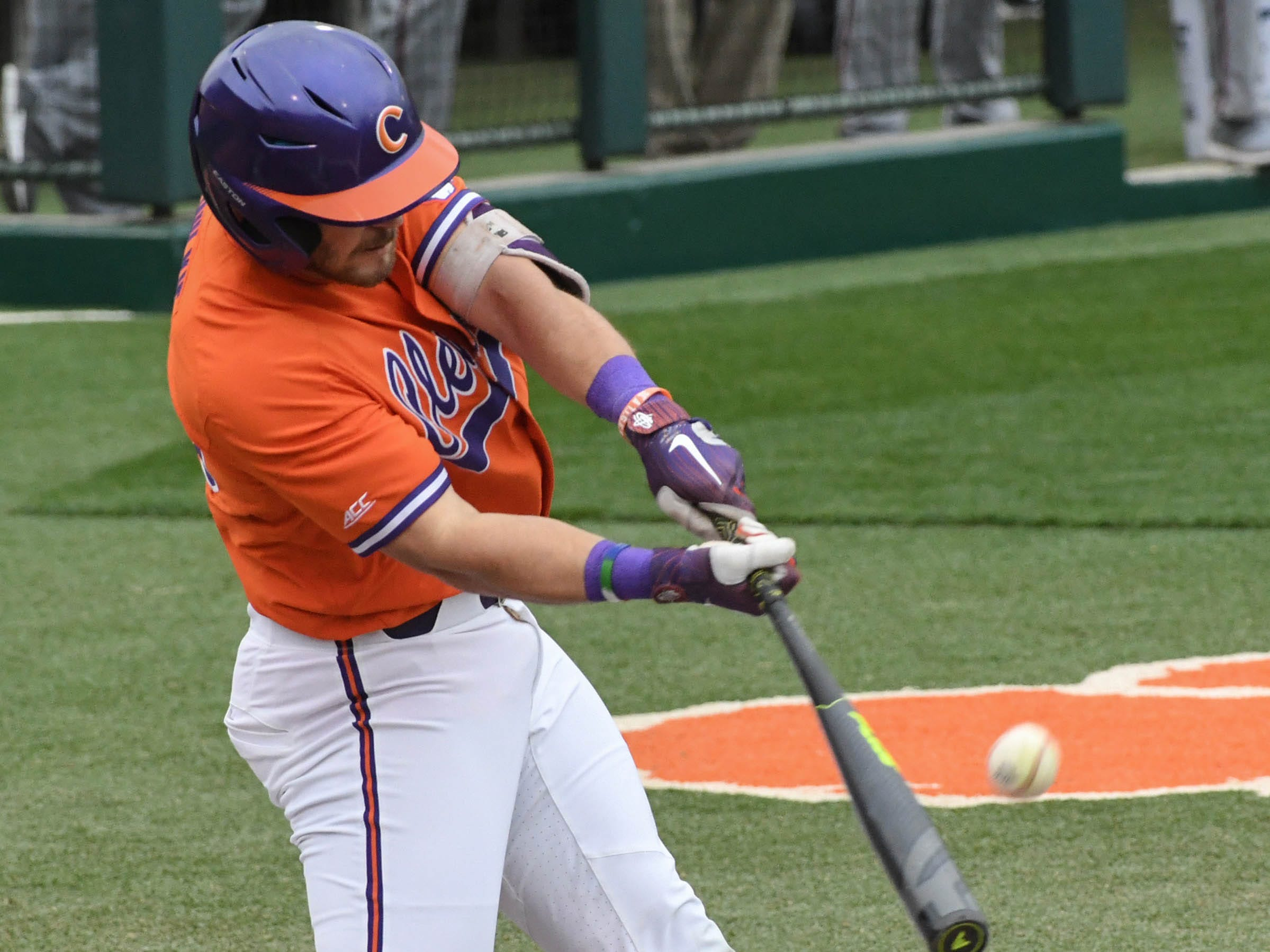 Clemson junior Kyle Wilkie(10) hits a ball against South Alabama during the bottom of the first inning at Doug Kingsmore Stadium in Clemson Friday, February 15, 2019.