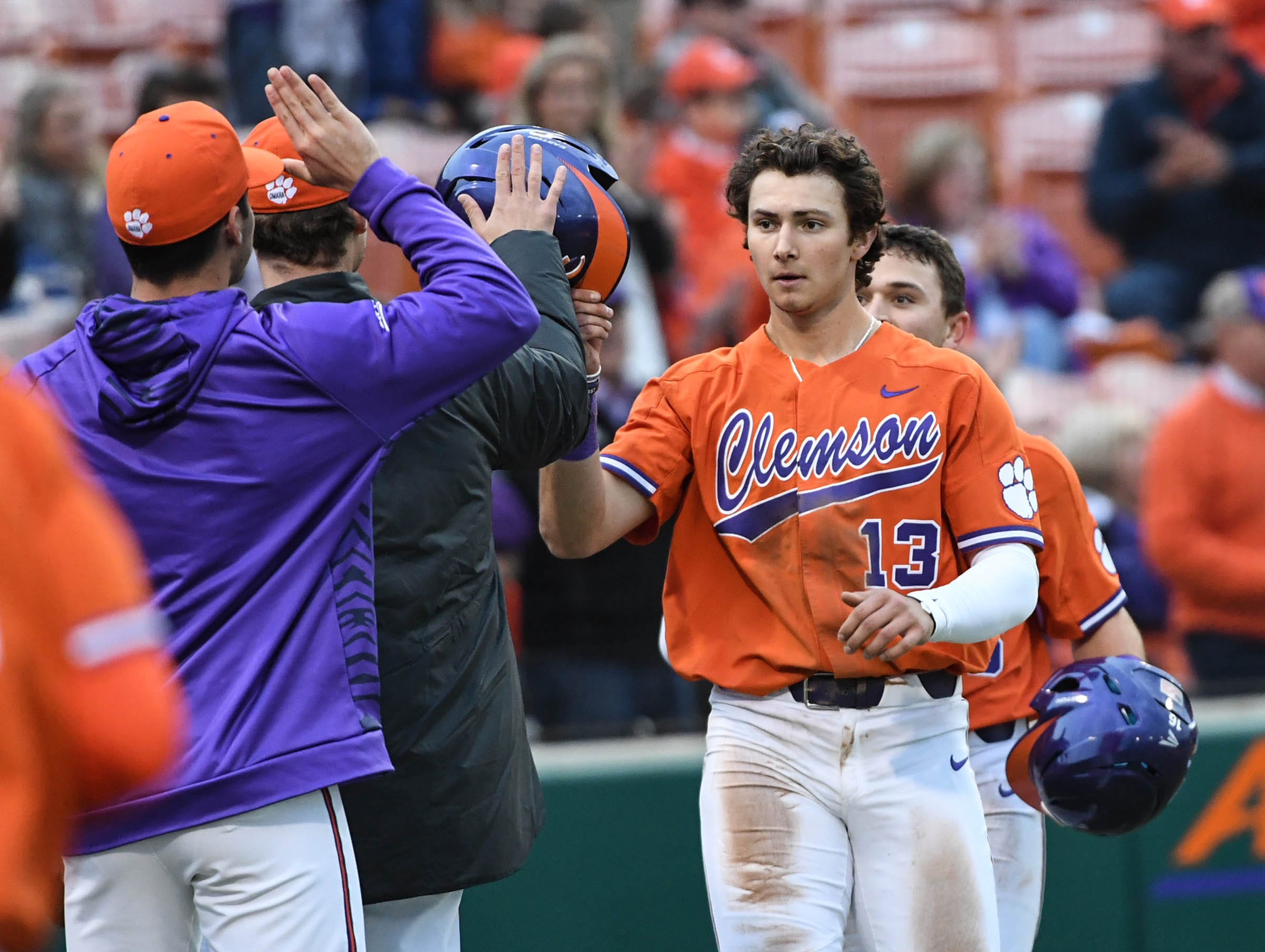 Clemson sophomore Sam Hall(5) single drove in sophomore Bryce Teodosio(13), left, and sophomore Bo Majkowski(16), right, against South Alabama during the bottom of the eighth inning at Doug Kingsmore Stadium in Clemson Friday, February 15, 2019.
