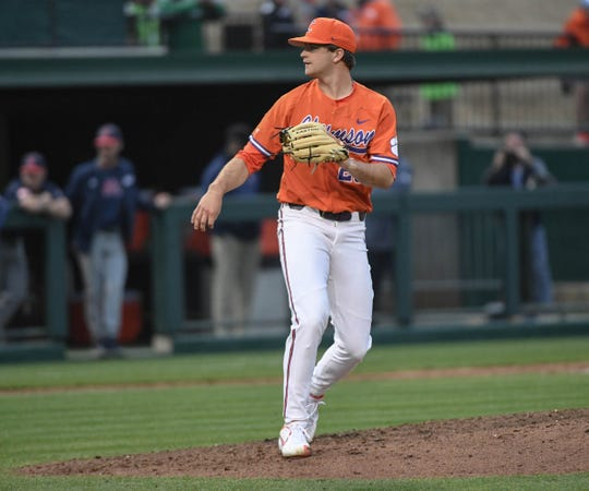 Clemson junior Carson Spiers(23) pitches against South Alabama during the top of the ninth inning at Doug Kingsmore Stadium in Clemson Friday, February 15, 2019.