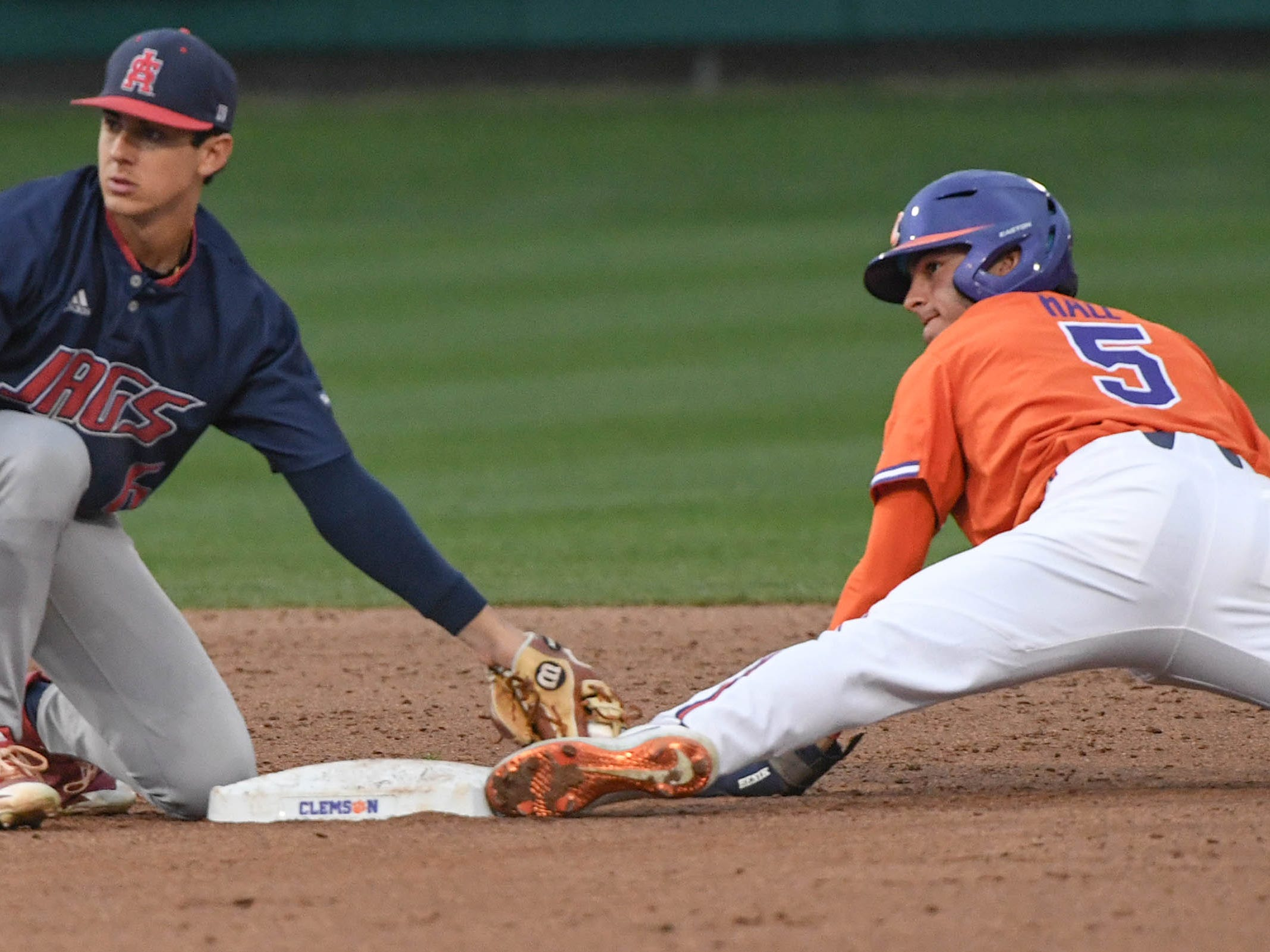 Clemson sophomore Sam Hall(5) steals second base past the tag of South Alabama infielder Santi Montiel (6) during the bottom of the eighth inning at Doug Kingsmore Stadium in Clemson Friday, February 15, 2019.