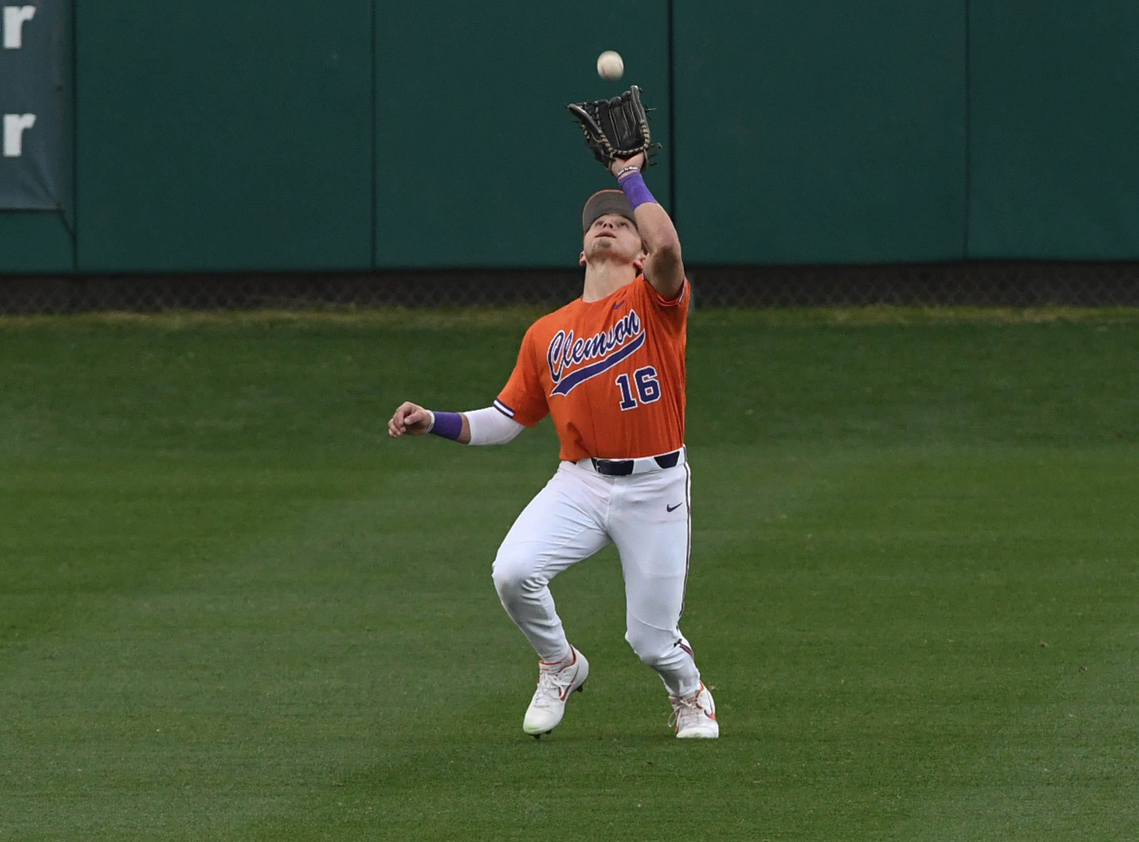 Clemson sophomore Bo Majkowski(16) catches a fly ball against South Alabama during the top of the sixth inning at Doug Kingsmore Stadium in Clemson Friday, February 15, 2019.