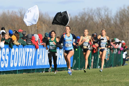 Neenah native Jessica Parker, center, will be honored by Marquette University for her athletic and academic achievement, along with her work in the community.