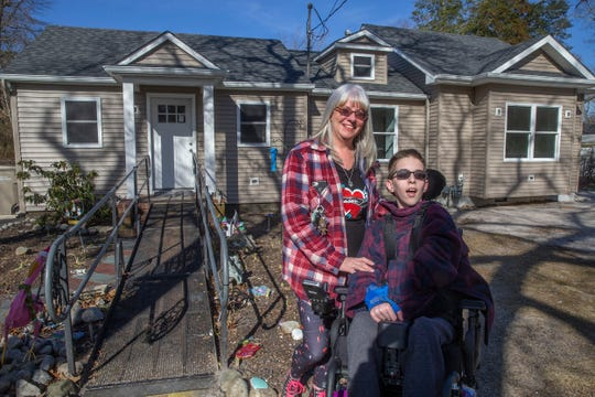 15-year-old Val Falzarano and his mom Kim Falzarano at their under-construction home. Val is severely disabled and needs a customized bedroom and bathroom.