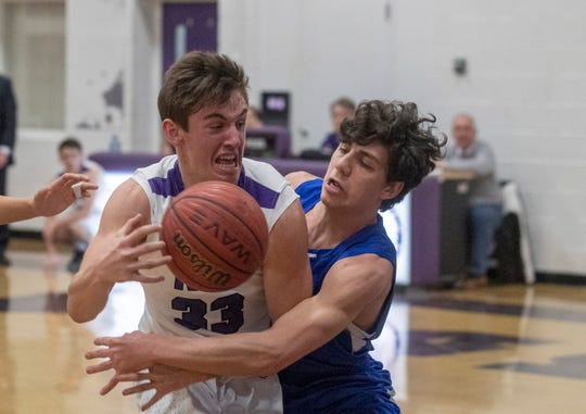 Rumson's Drew Frankel drives to the basket through traffic during first half action in Holmdel Boys Basketball vs Rumson-Fair Haven in Rumson, NJ on February 14, 2019.