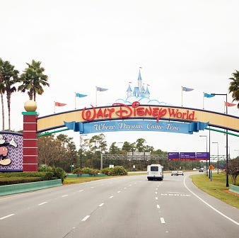 Orlando, Florida, USA - November 25, 2013: Walt Disney World main entrance sign as seen driving from the south on World Drive into the park.