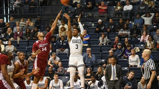 Monmouth's Deion Hammond launches a shot against Rider earlier this season at OceanFirst Bank Center in West Long Branch.