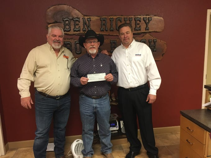 Kerry Fortune (center) receives a $50,000 donation for the Ben Richey Boys Ranch & Family Program from the estate of Keith Craig, presented by James Baker and Joseph Alves, estate executor.