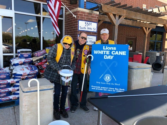 Abilene Founders Lions Club members participate in National White Cane Day at the United grocery store on South 14th Street. From left: Marsha Lemry, David Batiz and club president Jeff Eckard.