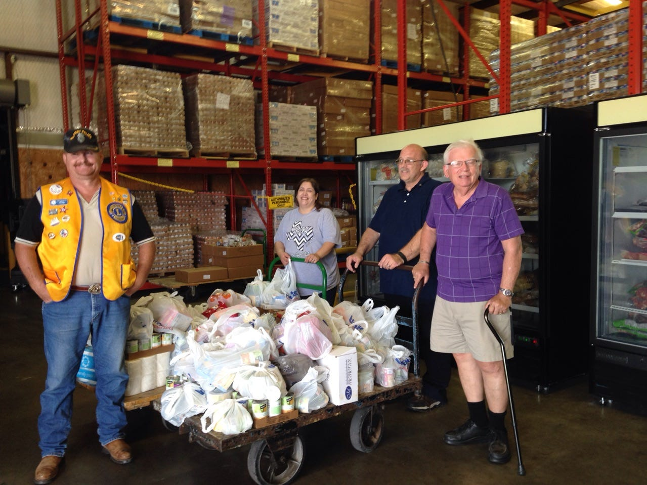 Members of the Abilene Cactus Lions Club present the proceeds of the second annual fundraiser to the Food Bank of West Central Texas – $622 and more than 700 pounds of food.