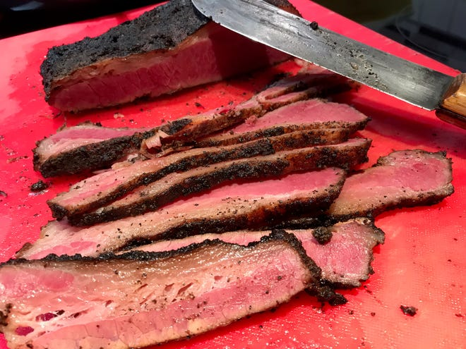 The distinct pink color of pastrami comes from using curing salt.