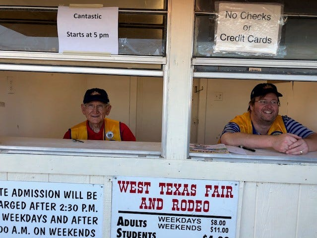 Abilene Founders Lions Club members Gene Goodwin and Tim Renfro work the ticket booth at the West Texas Fair & Rodeo.