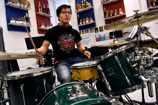Cooper High School sophomore Ricardo Hinojosa practices on the drums in the band hall Tuesday.