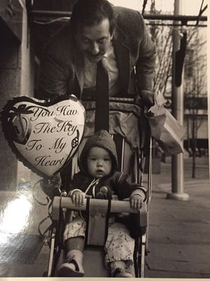 Ned Jennings, former managing editor of the Asheville Citizen Times, strolls with his daughter Casey Blake outside of the Citizen Times building in 1988. Jennings died of cancer in 2009.