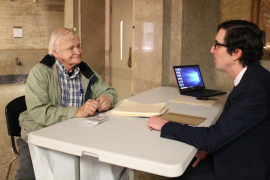 Pisgah Legal Services attorney Thomas Lodwick, right, talks with David Todd, who lives in a Buncombe County trailer park and had issues with eviction.